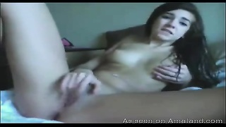 Humorous Sweetheart Smiling And Chuckling From Enjoyment In The Course Of Masturbation